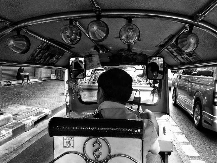 Rear view of a man driving auto rickshaw