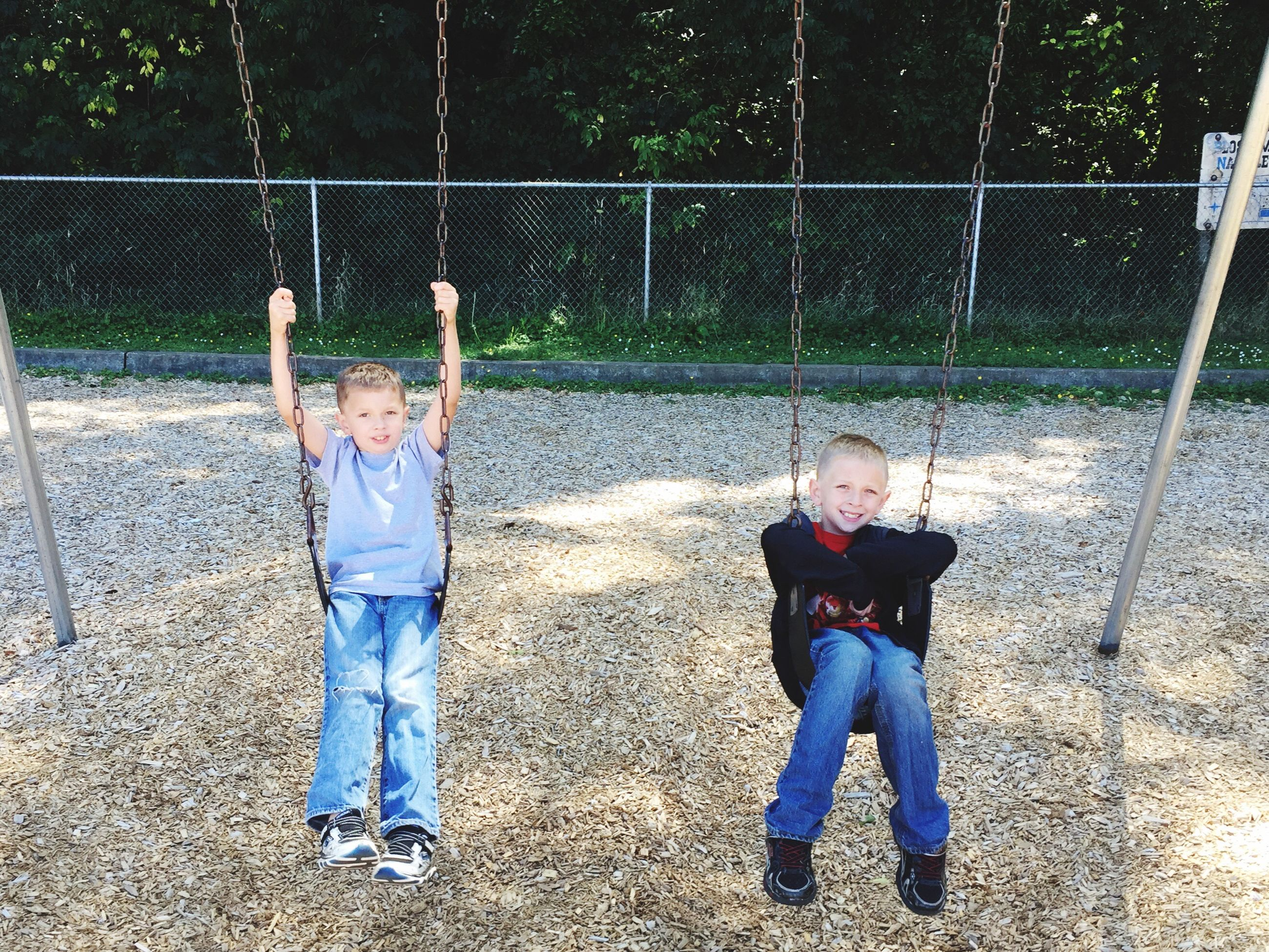 childhood, elementary age, togetherness, casual clothing, full length, boys, girls, playing, love, bonding, person, sibling, leisure activity, lifestyles, standing, sister, smiling, brother, preschool age, motion, day, friendship, family, fence, innocence, enjoyment, fun, outdoors