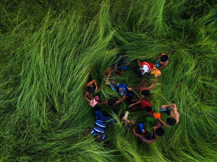 High angle view of people lying on grass