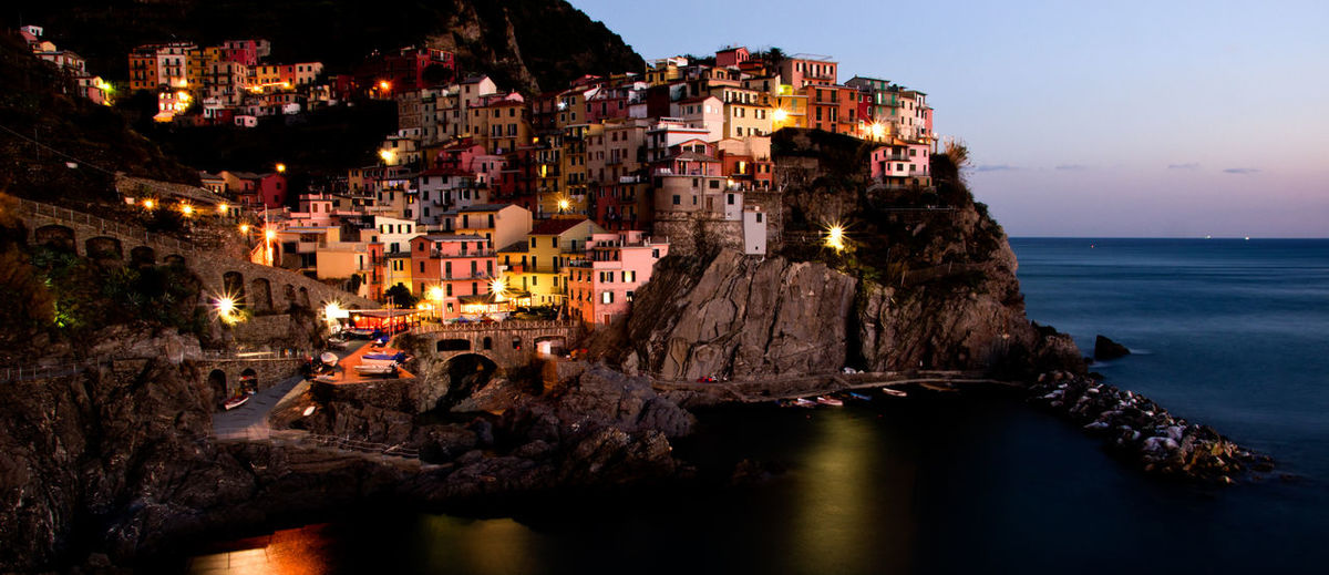 Water Sea Illuminated Architecture Building Exterior Built Structure Sky Night No People Travel Destinations Waterfront Reflection Dusk Travel Village Cinque Terre Twilight Building Land Lights