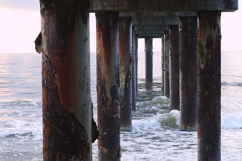 Scenic view of sea against sky seen through pier