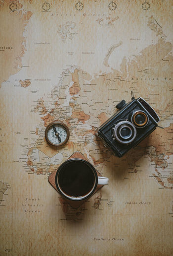 Drink Directly Above No People Indoors  Cup High Angle View Coffee Mug Old Camera Vintage Map Adventure Compass Planning A Trip Planning Flatlay