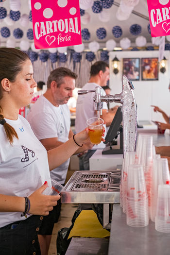 Malaga, Spain - August 12, 2018. A Spanish woman fills a glass of beer at the Feria de Malaga, an annual event that takes place in mid-August and is one of the largest fiestas in Spain Beer Feria Malaga SPAIN Spanish Spanish Food Spanish Woman Adult Beer - Alcohol Beer Glass Beer Time Business Cafe Cartojal Communication Drink España Feria De Malaga Festival Food And Drink Group Of People Holding Indoors  Men Occupation Real People Refreshment Restaurant Spaın Standing Text Verano Women Young Adult Young Men EyeEmNewHere Summer In The City
