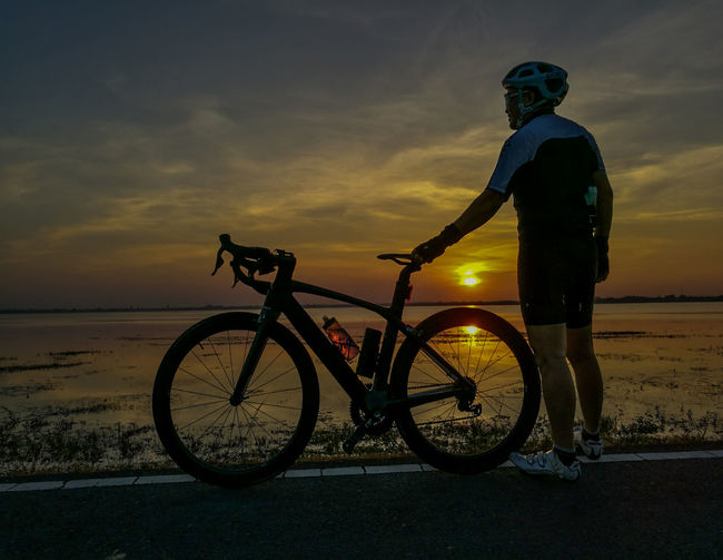 My Year My View Sunset Bicycle Cycling Travel Silhouette Vacations One Person Outdoors Sun People Men Only Men Sea One Man Only City Adults Only Adult Beauty In Nature Nature Biker RhinoSurinCyclingClub Clinging To Life Cyclingphoto Thailand