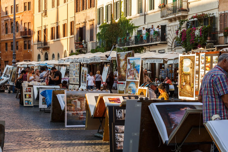 Moving Around Rome Piazza Navona Adult Architecture Awning Building Exterior Built Structure City Day Large Group Of People Market Outdoors People Real People Retail