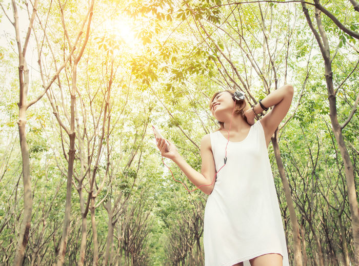 Adult Beautiful Woman Casual Clothing Day Forest Growth Hairstyle Happiness Human Arm Land Leisure Activity Lifestyles Nature One Person Outdoors Plant Real People Standing Three Quarter Length Tree Women Young Adult Young Women