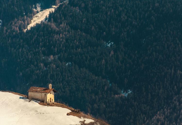High angle view of chapel on mountain peak