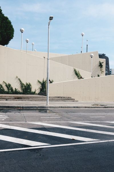 Street Light Road Street Architecture Built Structure Road Marking Clear Sky Building Exterior Day Outdoors Dividing Line Concrete Sky No People White Line