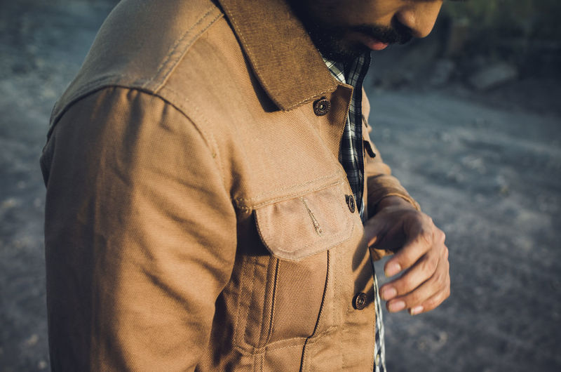 Midsection of man wearing jacket