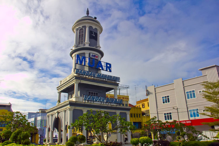 Clock Tower at Muar, Johore, Malaysia Muar Clock Tower Muar Johore Architecture Building Exterior Built Structure City Clock Tower Cloud - Sky Day Large Group Of People Low Angle View Men Outdoors People Real People Sky Spirituality Tree