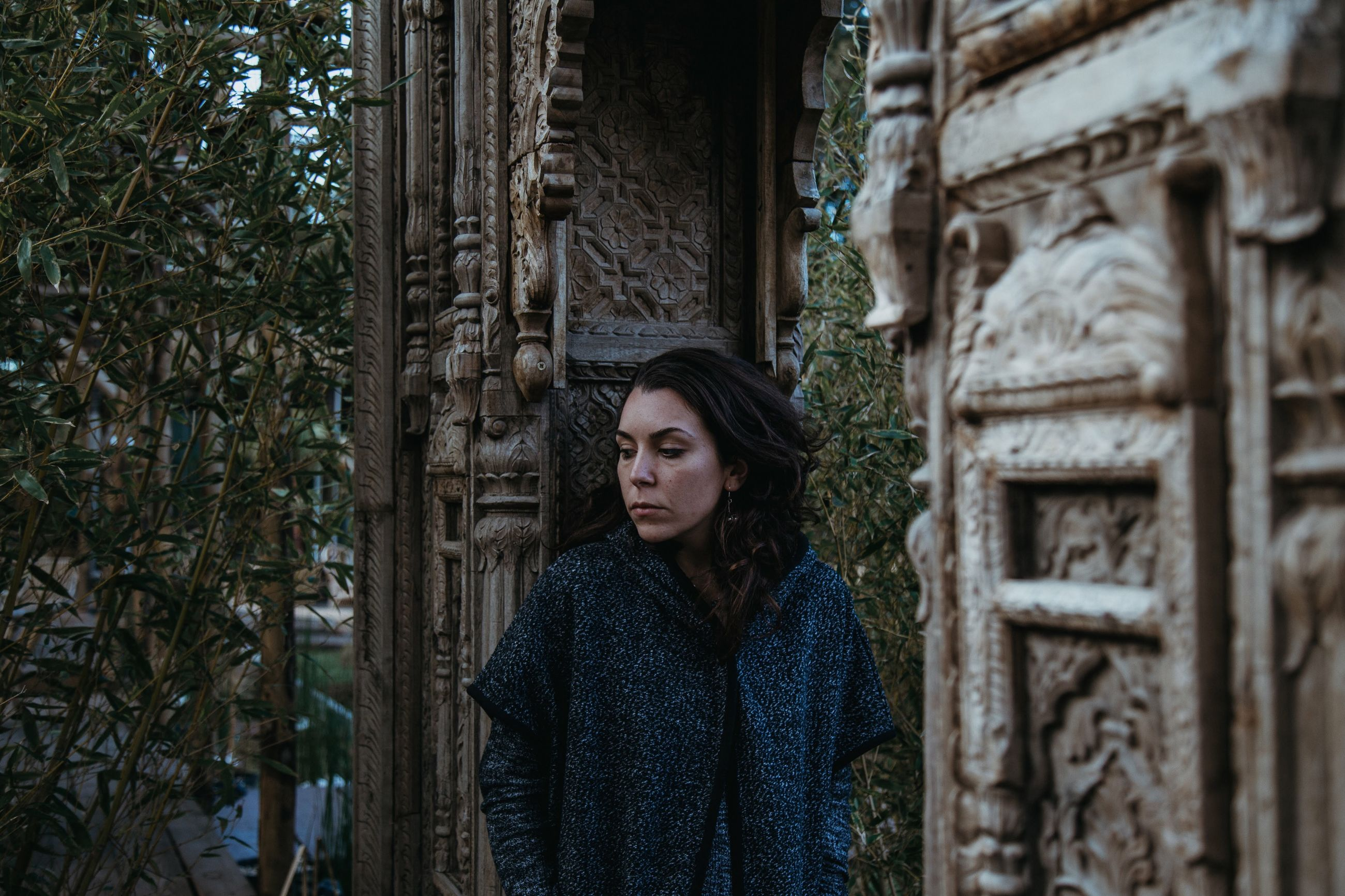 one person, real people, young adult, outdoors, lifestyles, young women, looking at camera, day, portrait, architecture, women, nature, adult, people