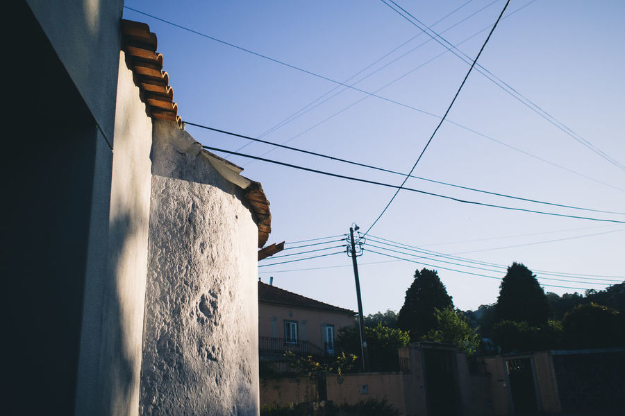 morning light Architecture Blue Building Exterior Built Structure Cable Day Electricity  Hikinggalicia House Low Angle View Morning Light No People Power Cable Power Line  Power Supply Residential Structure Sky Technology Telephone Line Telephone Pole Town Wire