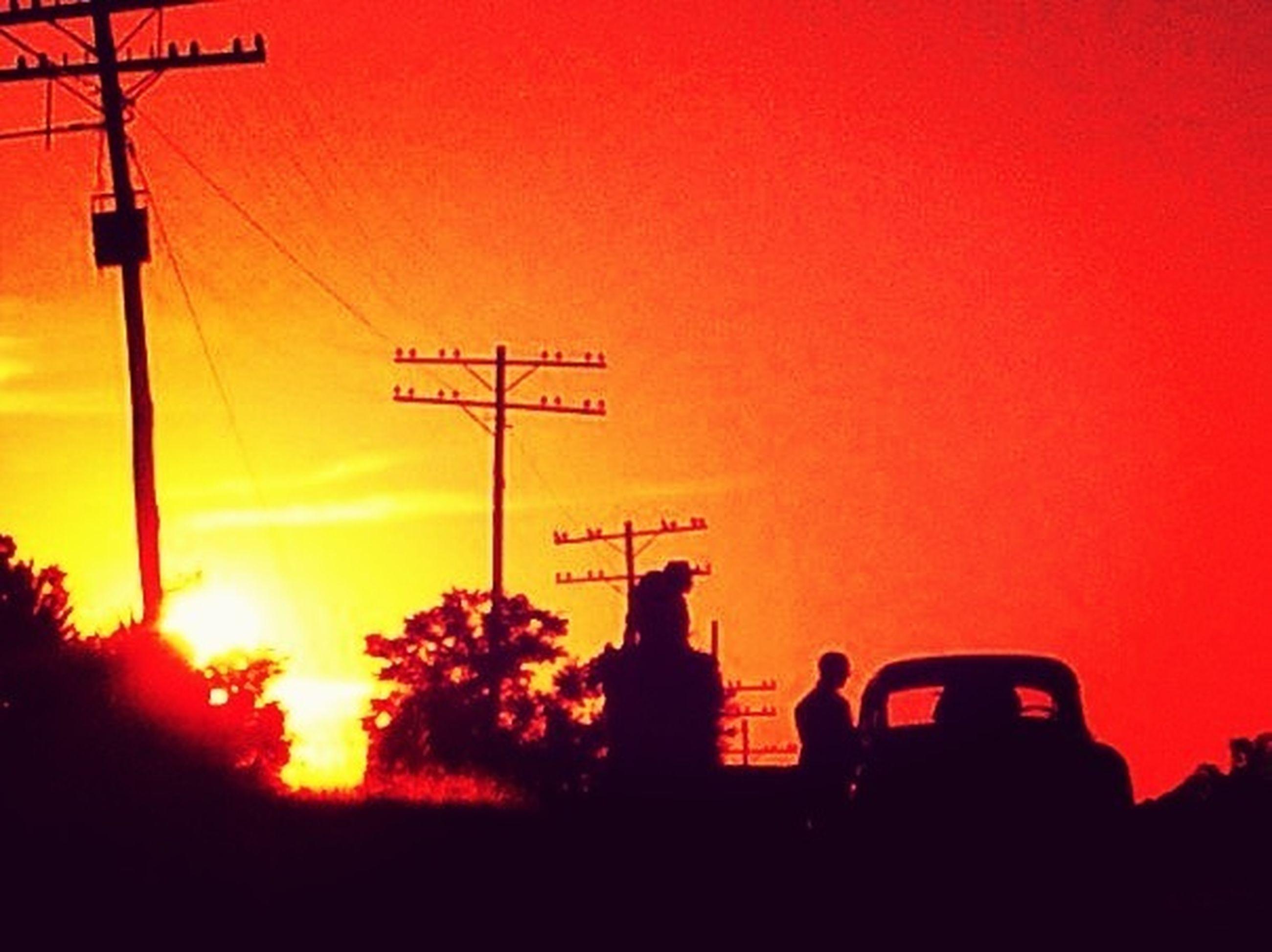 sunset, silhouette, orange color, clear sky, communication, transportation, copy space, tree, men, mode of transport, sun, lifestyles, leisure activity, land vehicle, sunlight, nature, outdoors, car