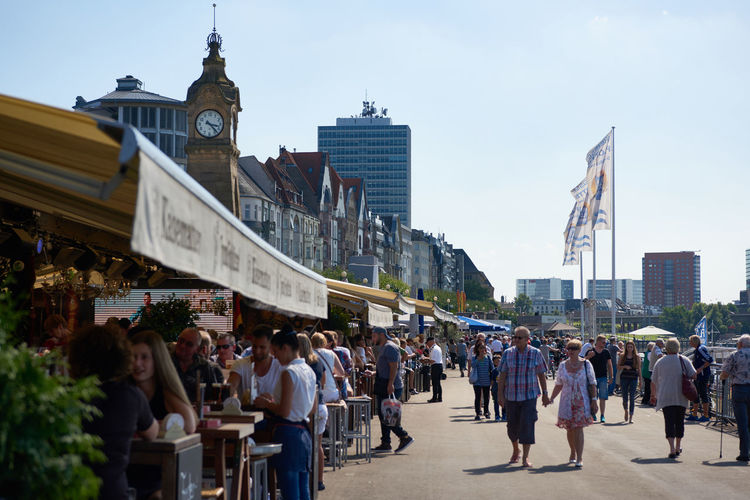 DUESSELDORF, GERMANY - AUGUST 17, 2016: Visitors enjoy the Rhine promenade with its historic houses along river Rhine Altstadt Atmosphere Bar Blu Sky City City Life City Life City Street Daytime Düsseldof High Resolution Large Group Of People Lifestyles NRW Outdoors People R Relaxing Restaurant Rheinland-Pfalz  Rhine Promna S Shopping Tourism Travel Destinaton