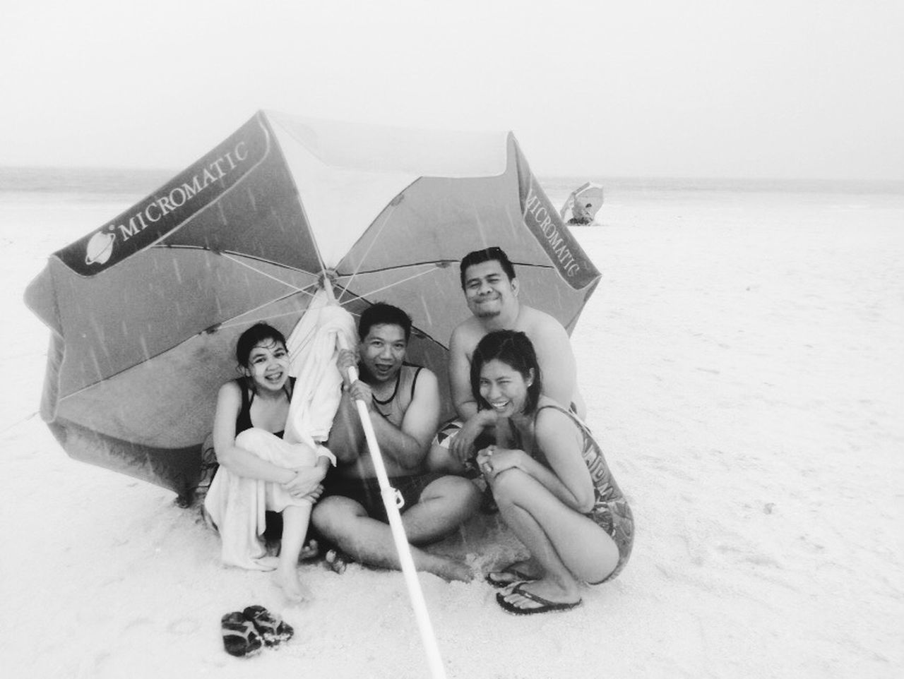 beach, childhood, boys, happiness, togetherness, friendship, vacations, fun, holding, leisure activity, full length, cheerful, portrait, outdoors, enjoyment, sand, looking at camera, summer, day, child, sea, sitting, smiling, group of people, girls, real people, young adult, water, young women, sky, people