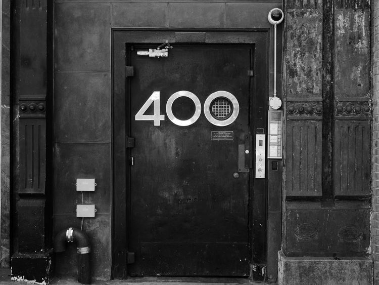 400 Doors NYC Street NYC Street Photography Architecture Black And White Photography Building Exterior Built Structure Close-up Communication Day Door No People Nyc Streets Outdoors Street Number