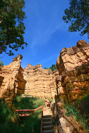 Beautiful place from Naturally Plant Sky Tree Nature Rock Day Rock Formation Blue Solid Rock - Object Tranquility Beauty In Nature Tranquil Scene Outdoors Tourism Eroded Rocks Eroded Landscape Eroded Mountain Travel Destinations Quite Place Beauty In Nature History The Past Scenics - Nature Enjoying The View