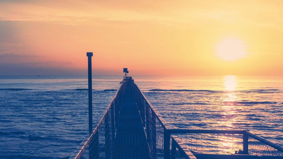 Sunset Wood - Material Sea Water Horizon Over Water Pier Scenics Beauty In Nature Sunlight Nature No People Tranquility Outdoors Sky Built Structure Jetty Tranquil Scene The Way Forward Wood Paneling Day