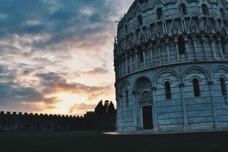 Piazza dei miracoli against sky during sunset