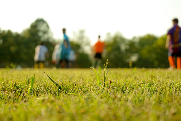 Grass Field Incidental People Surface Level Outdoors Sport Real People Leisure Activity People Selective Focus Group Of People Teenager