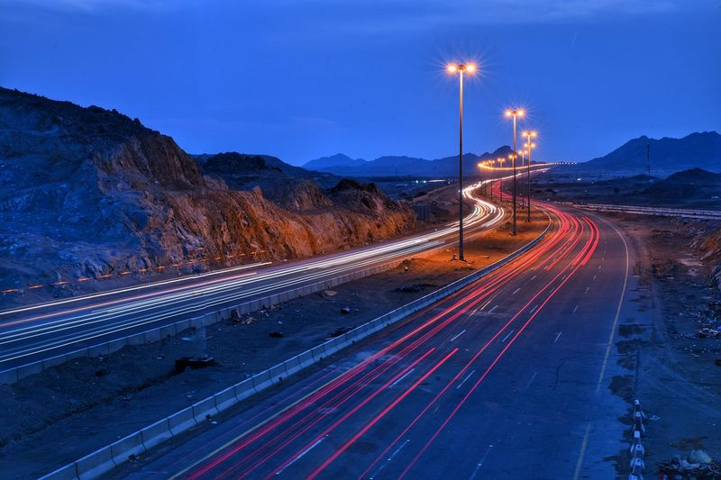 Light trails on highway at dusk