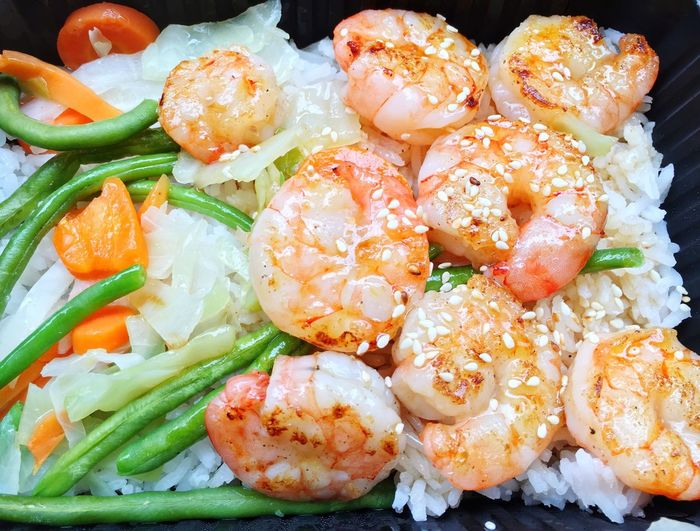 High Angle View Of Prawns With Rice In Box