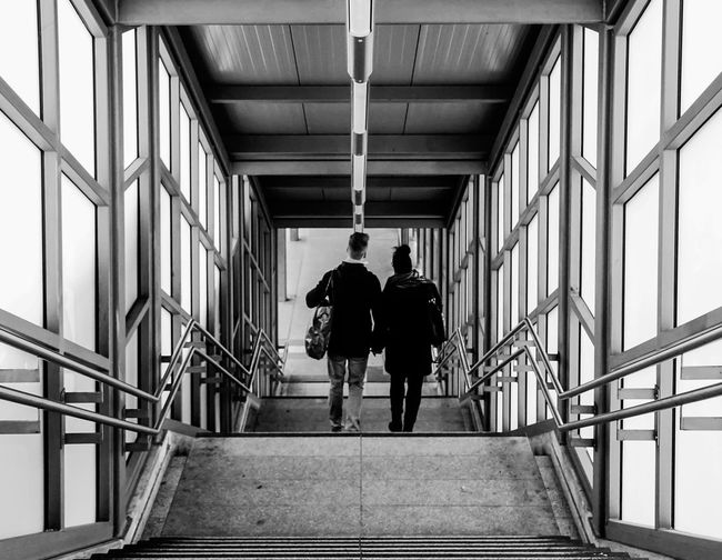 downstairs ... Architecture Berlin Real People Building Ceiling Wall Window Corridor Staircase Steps Railing Perspective Indoors  Treppe Personen Architecture_bw Downstairs Abwärts Paar Bahnsteig  Contemporary Occupation S-bahnhof Steps And Staircases Diminishing Perspective Full Length Walking Rear View Men Indoors  Two People Built Structure Togetherness Lifestyles Standing Friendship Adult People Krull&Krull Streetphotography