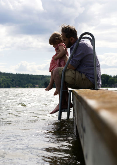 Water Leisure Activity Two People Cloud - Sky Real People Togetherness Emotion Love Sky Positive Emotion Full Length Parent Father Daughter Girl Mälaren Lake Nature People Day Outdoors Trust Trusting Dipping Swedish Lifestyle