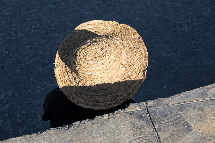 High Angle View Of Person Wearing Wicket Hat On Street