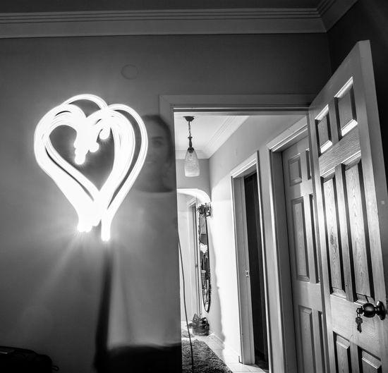 the girl with light - Berrak Gönül BERRAK GÖNÜL Hanging Low Angle View Indoors  No People Illuminated Lighting Equipment Girl Light Heart Portrait Long Exposure Blackandwhite Blackandwhite Photography