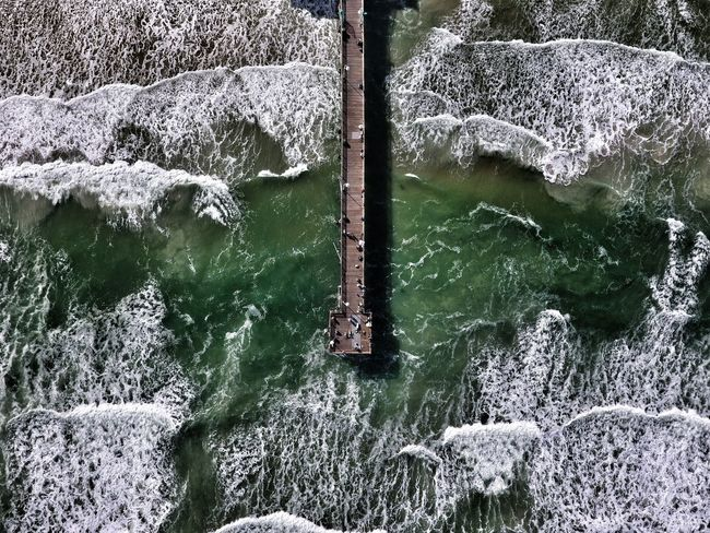 Pier at the seaside Waves Seaside Aerial View Aerial Photograph Bird's Eye View Copy Space Adventure Adventure Drone  Sea Water Coast Green White Daytona Florida USA