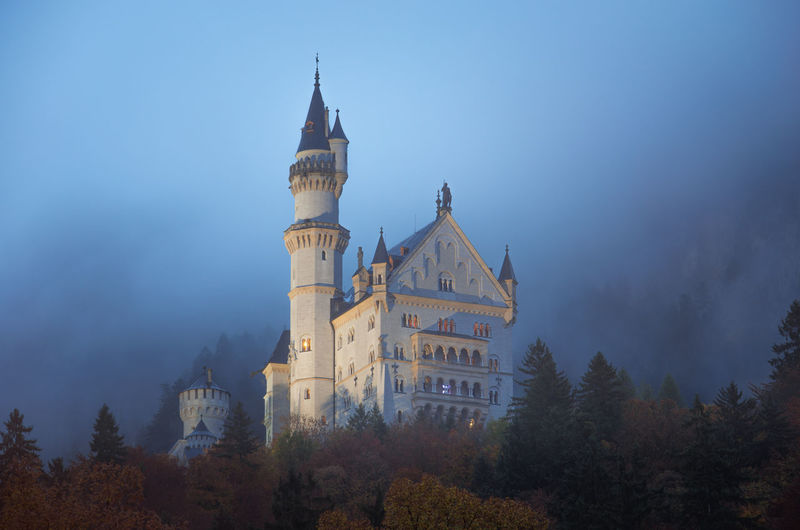 Neuschwanstein Castle with Autumn colors, Fussen, German Built Structure Architecture Tree Building Exterior Building Plant Sky Place Of Worship Religion Nature Travel Destinations Belief Spirituality No People The Past History Tower Travel Outdoors Spire