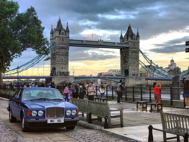 EyeEm LOST IN London London Tower Bridge and a classic blue Rolls Royce Silver Shadow. Built Structure Architecture Bridge - Man Made Structure Sky Connection Engineering Tourism Suspension Bridge Travel Destinations Transportation Cloud - Sky Travel Real People Building Exterior Bascule Bridge Outdoors Men Women City Large Group Of People Rolls Royce Silver Shadow