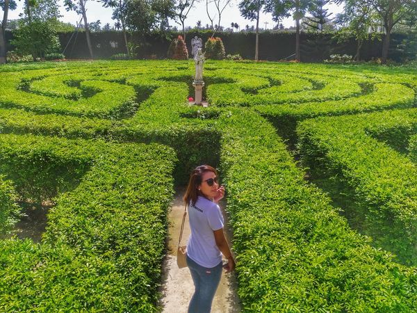 The Maze in Toledo, Cebu, Philippines Growth Green Color Field Grass One Person Casual Clothing Nature Day Outdoors Shadow Real People Standing Adults Only Only Women Women One Woman Only Young Women Agriculture People Lifestyles Maze Runner Mazedonien Indoors  Mazuria Lake District Maze Pathway