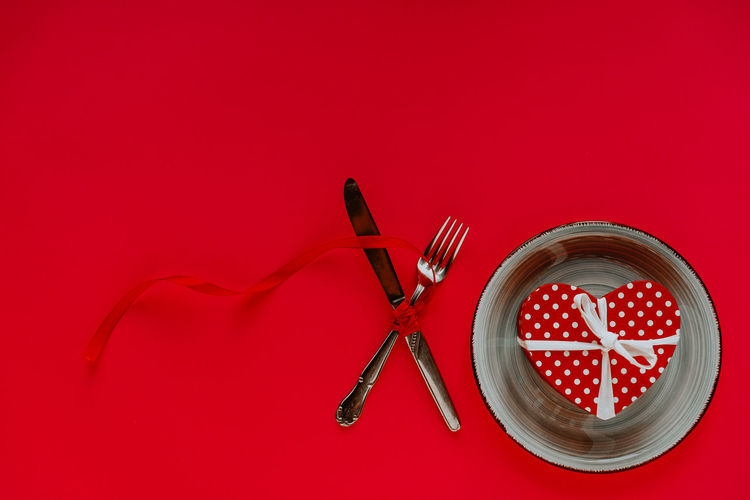 High angle view of fire on table against red background