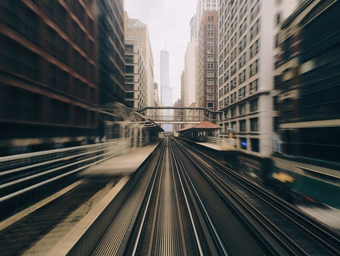 Blurred motion of railroad track in city