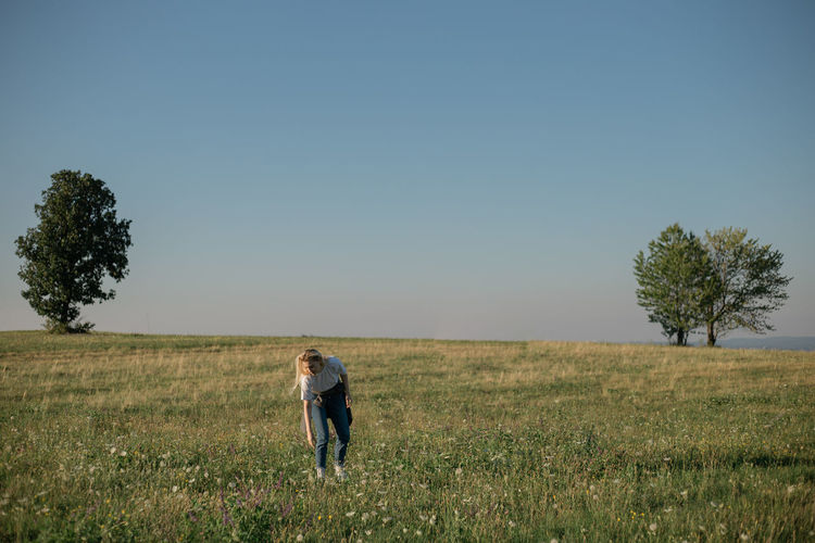 View of a young woman in an open field