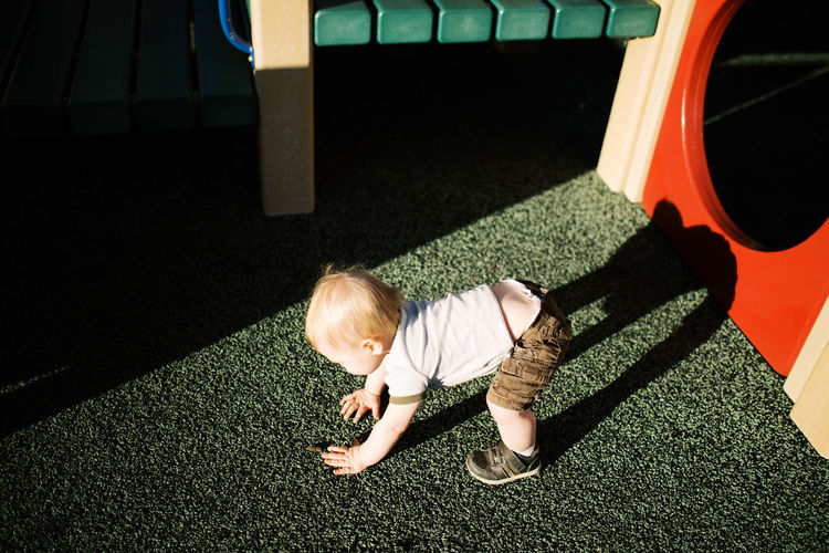 High angle view of boy on floor