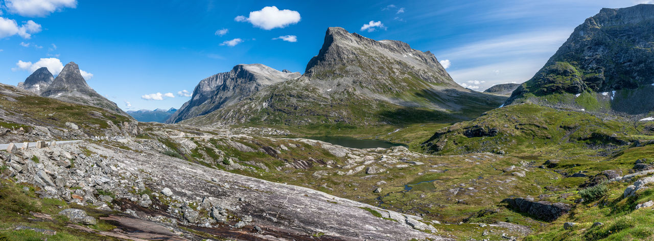 Beauty In Nature Bispen Blue Cloud Day Idyllic Landscape Majestic Mountain Mountain Range Nature Norway Panorama Remote Rock Rock - Object Rock Formation Rocky Rocky Mountains Scenics Sky Sunlight Tranquility Trollstigen Nature's Diversities