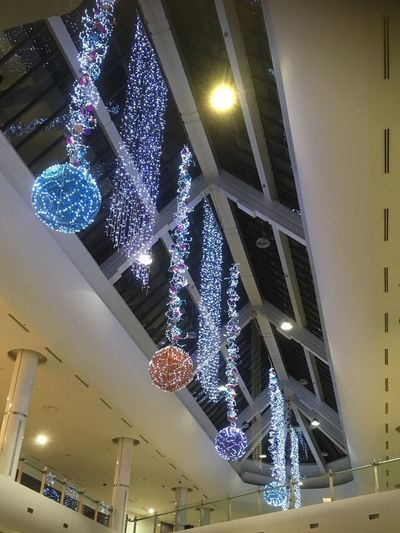 MK Illuminations Illuminated Lighting Equipment Celebration Christmas Decoration Hanging Low Angle View Christmas Decoration Ceiling Christmas Tree Christmas Lights Indoors  Tradition Electric Light Glowing Night Christmas Ornament Electricity  No People Tree Topper Top Team Metro Centre At Work