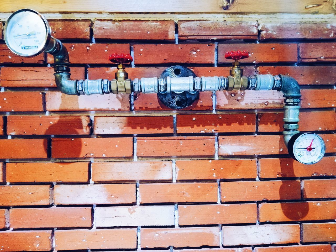 brick, brick wall, wall, no people, wall - building feature, built structure, day, architecture, technology, connection, metal, outdoors, close-up, pipe - tube, pattern, industry, instrument of measurement, accuracy, meter - instrument of measurement