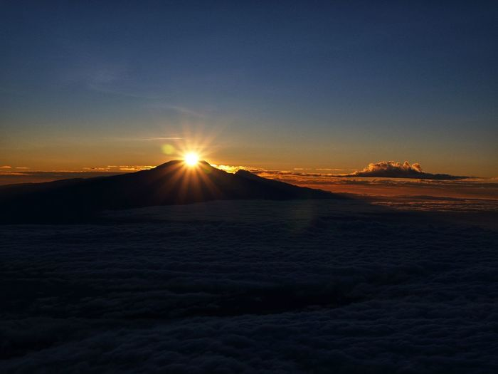 Sun rising over Kibo crater on Mt. Kilimanjaro (5895 m) in Tanzania. View from top of Mt. Meru (4562 m). Nature Sky Mountain Beauty In Nature Outdoors Scenics Travel Destinations No People Landscape Sunrise Kilimanjaro MountKilimanjaro Meru Africa Tanzania Morning EyeEmNewHere Olympuscamera