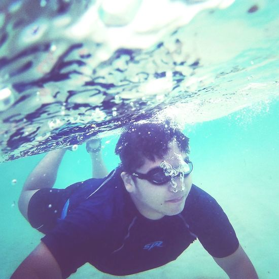 One Person Underwater Looking At Camera Portrait Water Swimming Close-up Adult Lifestyles Leisure Activity Swimming Goggles Day People Motion Swimming Pool Naturelovers Nature Photography DIY Oceanlife Scubalife Diving GoogleGlass Philippine Islands Underwater Photography UnderSea