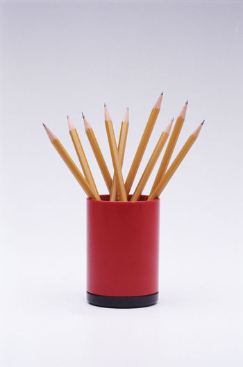 Close-up of red pencils on white background