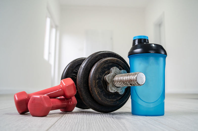 Weight Sports Training Weights Weight Training  Indoors  Dumbbell Exercise Equipment Exercising Healthy Lifestyle Muscular Build Sport Lifestyles Wellbeing Still Life Sports Equipment Strength Focus On Foreground Vitality Close-up Gym Self Improvement
