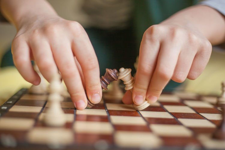 Arts Culture And Entertainment Board Game Chess Chess Piece Finger Game Hand Human Body Part Human Hand Indoors  Leisure Activity Leisure Games Lifestyles One Person Playing Real People Relaxation Selective Focus Skill  Strategy Table