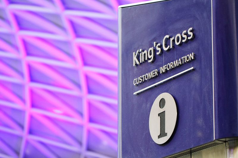 A King's Cross Train Station Information sign denoting the location of the customer service help desk under the familiar King's Cross Station lattice roof. King's Cross, St Pancras International Kings Cross Kings Cross Station Roof Lattice Train Station Customer Service Sign Signs Architecture London LONDON❤ Train Station Platform Train Stations Help Help Desk Information Information Sign Travel Uk Colourful Colourfull Purple Transportation Transport