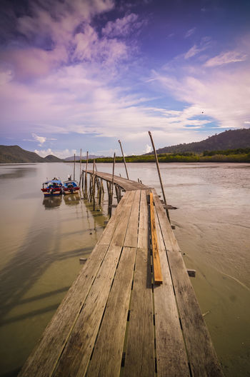 Waiting for boat Beauty In Nature Cloud - Sky Day Jetty Lake Moored Mountain Nature Nautical Vessel No People Outdoors Scenics Sky Sunset Tranquil Scene Tranquility Transportation Water Wood - Material