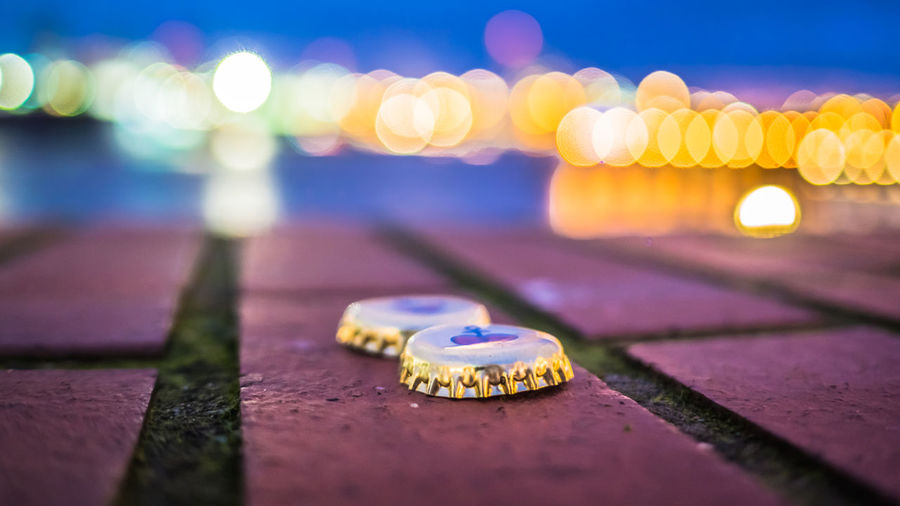 2beers Brickwall Elbe River Industry Riverside Bottle Caps Brick Capsule Close-up Elbe Harborfront Illuminated Night No People Outdoors Two Beers Please! Waterfront The Still Life Photographer - 2018 EyeEm Awards
