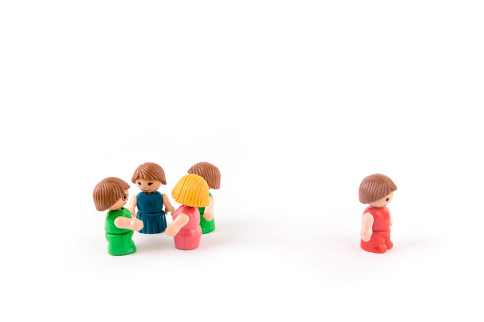 Five people with one being isolated over white background Alone Friends Isolate Lonely Teamwork Boycott Boys Child Childhood Copy Space Friendship People Team White Background